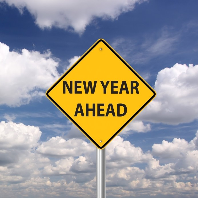 """A yellow road sign that says """"New Year Ahead,"""" associated with supply chain logistics IT provider PINC as a top supply chain story of 2016 due to its ongoing efforts to deliver excellence in supply chain execution."""